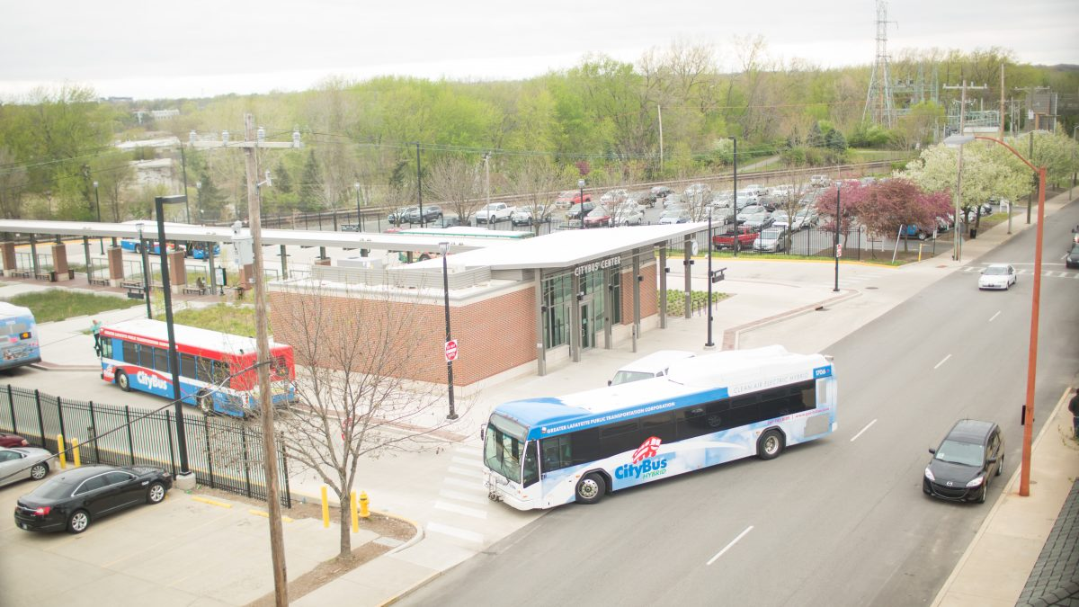 two buses pulling into the CityBus Center in Lafayette