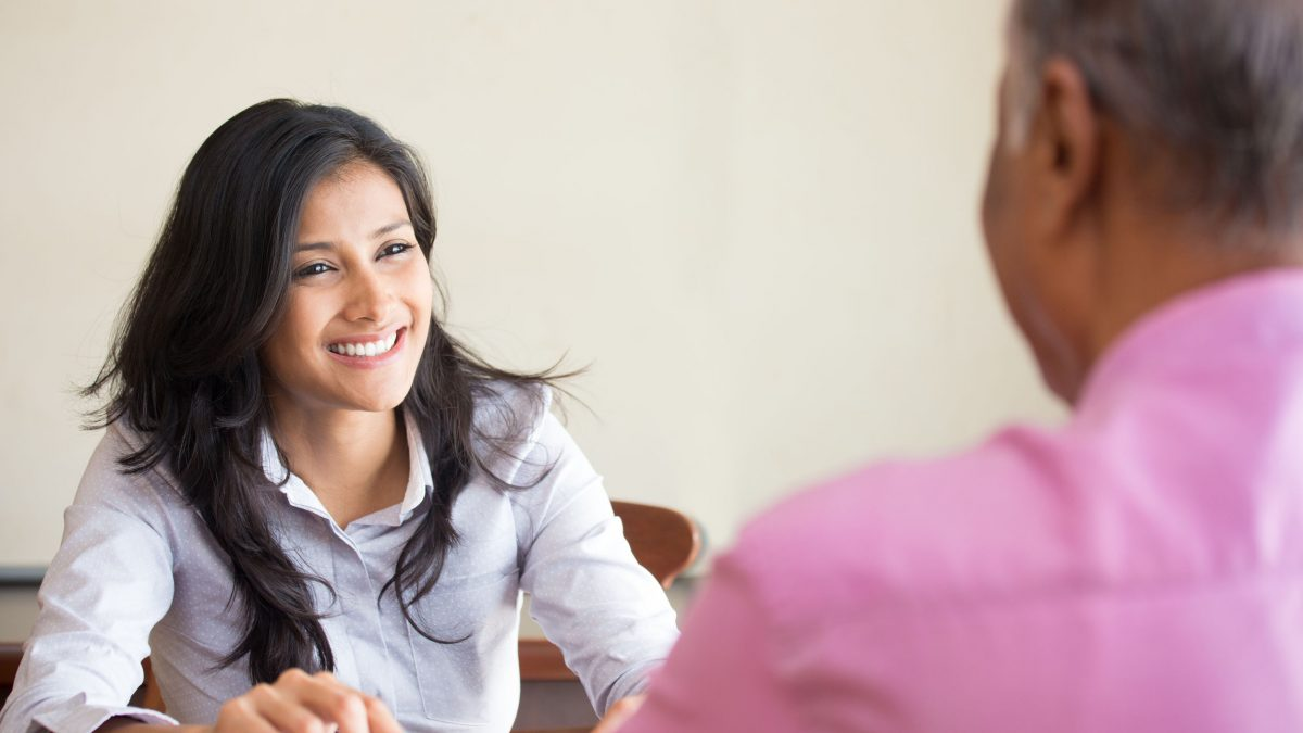 a smiling woman interviewing for a job
